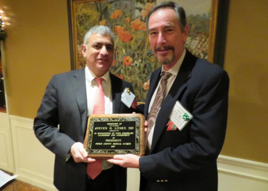 Incoming President Khash Dehghan, MD thanks Outgoing President Steven Litsky, MD for his service
