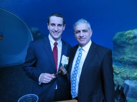 2019 PCMS President Aaron Pace, MD receives his gavel from 2018 President Khash Dehghan, MD